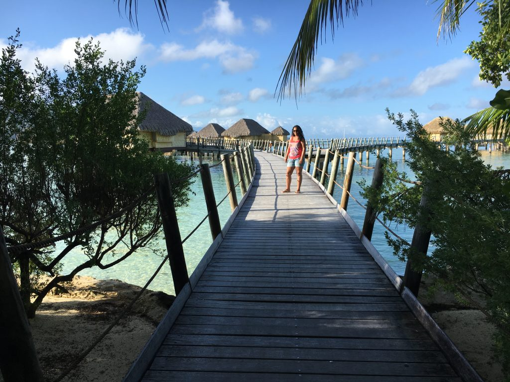 Boardwalk to the overwater bungalows at le Taha'a island resort and spa.
